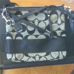 Black and grey fabric handbag It is a black and grey fabric Coach bag with black patent leather straps and handles and zipper part. Coach Bags Shoulder Bags