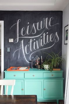 """Leisure Activities"" — chalkboard wall art in the dining room"