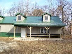 Metal Buildings-Post frame farmhouse with metal siding and roof
