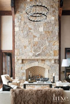 Fireplace: Contemporary Sitting Area with Tiered Candle Chandelier - Luxe Interiors + Design