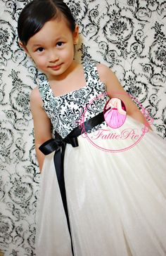 Flower Girl Dress. with a red ribbon