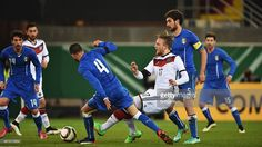 Philipp Hofmann of Germany is challenged by Matteo Bianchetti and Stefano Sturaro of Italy during...