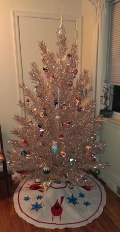Vintage 1950s Evergleam tinsel Christmas tree. Mid-century modern kitsch. With a Charlie Harper inspired tree skirt. Cute!