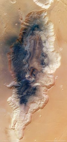 Hebes Chasma:This martian abyss, more than 4 times as wide and deep as the Grand Canyon,  is an enclosed, almost 8 km-deep trough stretching 315 km in an east–west direction and 125 km from north to south at its widest point. It sits about 300 km north of the vast Valles Marineris canyon.