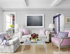 "To make the sofa in this Manhattan living room appear longer, designer Ashley Whittaker ordered a single cushion for the seat of the Century Furniture chesterfield, covered in a Rogers & Goffigon canvas: ""It's more comfortable than individual cushions — no one falls into the cracks."" The Billy Baldwin Studio slipper chair in a David Hicks linen from Lee Jofa is on a swivel, ""so you can turn and talk to people at either end of the room,"" and the acrylic coffee table opens up the seating area...."