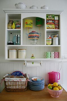 Kitchen closet - nice DIY for a vintage nursery with a hanging rail underneath- cute addition to homemade kitchen set