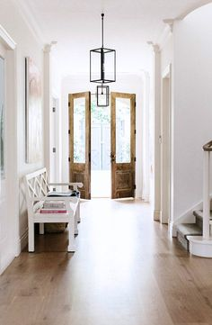 Light fixture- Entry hall to modern farmhouse, double front wood doors, chippendale bench, white, wood flooring. Design Entrée, House Design, Lobby Design, Design Ideas, Light Design, Graphic Design, Style At Home, Modern Farmhouse, Farmhouse Door