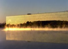 A massive corporate research facility, this project for Bell Telephone had Saarinen thinking of light and reflection. The monolithic glass structure's ideal location between two ponds gives it the appearance of a UFO landed on water.