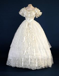 Wedding Dress: 1860 (adapted in 1949), English, lace, satin ribbon, silk net, skirt flounces of Limerick lace, hand embroidered machine net.