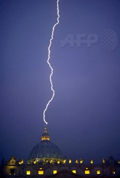 Lightning strikes St Peter's dome at the Vatican on day the Pope announced resignation.  by Filippo Monteforte