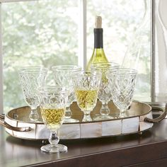 Lyndon Wine Glasses | A wide circular foot provides a substantial base for these wine glasses. An etched silhouette lends an elegant feel to any table setting. Set of six.