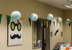 Hanging paper globes and a mustache-face poster -- easy decorating ideas!