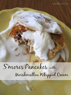 S'mores Pancakes with Marshmallow Whipped Cream - a treat of a breakfast that tastes awesome and makes everyone happy!
