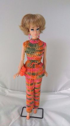 A 60s mod style outfit made from variegated yarn in pink, orange, and green. Handmade Barbie clothes and jewelry only. No doll included. She, her shoes, and stand are not included. The slim-fitting pants and the matching tunic snap closed in back. | eBay!