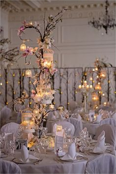 Candles make these blossom tree centrepieces from extra romantic - perfect for making winter weddings cosy! So unique!