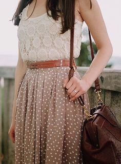 Lace top, belt, polka dot midi skirt and messenger bag.