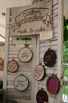 "What about a wall of embroidered hoops, with all the ""we go together like"" sayings ie, salt & pepper, milk & cookies as seen at http://www.etsy.com/listing/62722740/me-you-pencils-gold-engraved-natural"