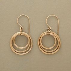 """CIRCLE OF THREE EARRINGS - In these three-circle hoop earrings, glimmering 14kt gold-filled rings go 'round and 'round in a trio of hoops that dance and sway harmoniously. Handmade in USA. Exclusive. 1-1/2""""L."""