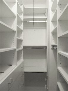 A small walk in closet designed by