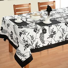 Hibiscus Printed Rectangular Table Linen- Like the midnight glory, in striking shades of black, the dazzling ebony hibiscus stands out against that explicit white background. Dinning Table Set, Dining Table Cloth, Table Linens, Fall Table Settings, Autumn Table, Table Accessories, Kitchen Linens, Kitchen Interior, Black And White