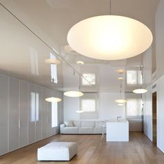 high gloss ceiling + reflections. O Apartment by Paritzki & Liani Architects