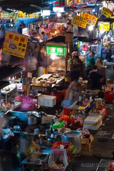 Food vendors prepare meals for patrons of the Snake Alley Night Market in Taipei, Taiwan | Darby Sawchuk