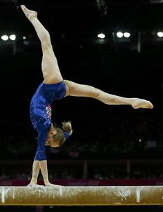 Russia's Victoria Komova performs on the balance beam during the women's individual all-around gymnastics final in the North Greenwich Arena at the London 2012 Olympic Games August 2, 2012.