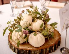 What a great centerpiece idea for a fall wedding or celebration! Wooden slab with mini white pumpkins, greenery/seeded eucalyptus, and purple flowers. Willowdale Estate, a weddings and events venue in New England. WillowdaleEstate.com | MKD Photography