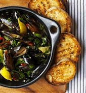 A global approach to pot-roasted bivalves. His recipe for pot-roasted mussels takes a similar worldly approach: The mussels begin in Italy, with olive oil and shallots, then veer straight into Spanish territory with the addition of a kicky aioli. Rather than adding any garlic at the beginning of the recipe, Toft adds the aioli at the end, bringing its sweet, pungent scent straight to the table.