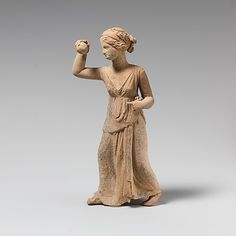Terracotta statuette of a girl playing ball  Period: Hellenistic Date: 3rd century B.C. Culture: Greek, South Italian