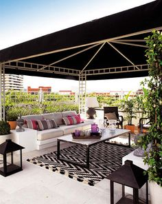 wonder if this looks too commercial for residential use...  outdoor rug and pavillion