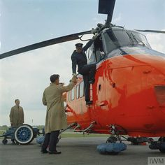 Ground crew handover to the pilot a Westland Whirlwind of The Queen's Flight at RAF Benson, Oxfordshire. Uav Drone, Drones, Westland Whirlwind, Earth Two, Experimental Aircraft, Aeroplanes, Royal Air Force, Cold War, Military Aircraft