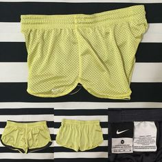 Nike women's athletic shorts sz M ⚽️⚾️ Nike women's athletic shorts sz M ⚽️⚾️ good used condition, yellow color with dark grey inner mesh and white swoosh, elastic drawstring waistband, mesh material is polyester See other Nike and athletic listings in my closet Nike Shorts