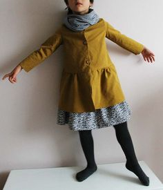 mustard jacket and polka dot gathered skirt (yes, I know this is a child, but I would still wear this)