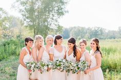Bridesmaids in ivory with green + white bouquets