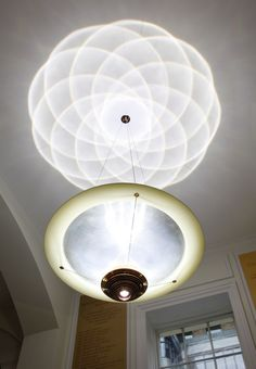 CIRCLES AND COUNTERCIRCLES CHANDELIERS BY TROIKA