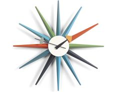 George Nelson Multi-Colored Sunburst Wall Clock by Vitra. The Nelson clocks were first born from a festive evening of collaboration.