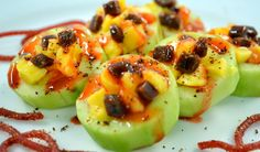 Pepino con Chamoy.  Cool cucumbers filled with fruits and tamarindo bits, topped with Chamoy and SnoCo's pica chamoy spice.