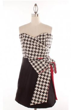 Judith March's famous wrap dress is back this year in a cute houndsooth/black/red combo, made just with you Alabama Game Day girls in mind! If you are looking for a perfect Alabama game day dress, check this one out! This item is available for pre-order only as part of the Judith March Game Day 2012 collection! This item is expected to ship on 9/15.
