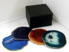 Set of 6 Assorted Colors Brazilian Agate Coasters Gift Boxed by Something Glassy. $49.00. Non-absorbant--these come in a gift box Set of 6 agate coasters. Using natural products are all the rage. These look terrific at the bar, pool side, or elegant table setting. Rubber bumpers on bottom to protect furniture--non-absorbant. The photo is only a sample of the coaster colors you may be getting. Agates come in varing shades of Purple, blue, teal, pink, black, red, brown.