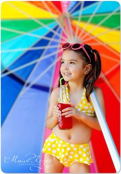 What a gorgeous beach style photo shoot.  I LOVE the rainbow of colours from that beach umbrella.