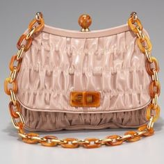 """Prada Light Pink Capretto Gaufre Shoulder Bag NWT Cammeo (light pink) goatskin. Golden and tan plexi hardware. Link chain shoulder strap. Framed top with push-lock ornament. Ruched body. Flap front with turn-lock closure. Inside, satin lining, one open pocket. 7""""H x 9""""W x 2""""D. Made in Italy.  NWT & dust bag and original box. Prada Bags Shoulder Bags"""