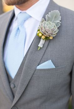 Brides.com: . A succulent boutonniere, accent with snowberries and dusty miller leafs, created by Designs by Jeremiah.