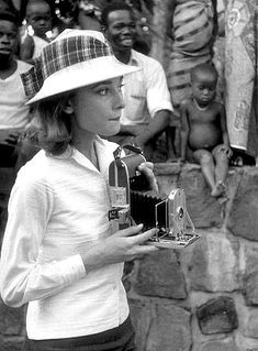Audrey Hepburn - taking her own photographs during filming of 'The Nun's Story', 1959.