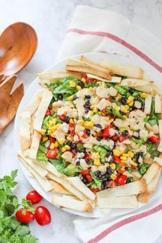 Mexican Chopped Salad with Chipotle Dressing is a hearty salad recipe made with fresh ingredients and surrounded by baked tortilla strips.