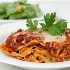 Lasagne  ground beef in a ready-made pasta sauce are layered with cottage cheese, ricotta cheese and Parmesan between uncooked lasagna noodles. Sprinkle mozzarella over the top and bake. It's that simple!