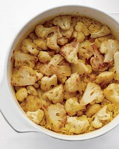One-Pot Curried Cauliflower Rice - Martha Stewart Recipes  This is SO good. I did tweak it a bit since I don't have a Dutch oven and made it in the cast-iron skillet. This required an hour in the oven but the results were AMAZING.
