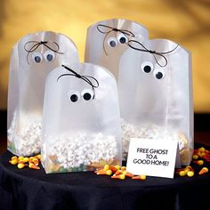 Friendly Ghost Bags     Frosted plastic gift bags become friendly ghosts with a quick trim off the tops. For each bag, simply round the top corners with scissors and apply two googly eyes. Fill the bag with popcorn or Halloween treats, punch two small holes through the top, thread a black cord through the holes, and tie in a bow. They'll fly out the door!