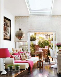 Lovely work/life space with lots of light. Love the sky light, the Roman shades and the daybed on the raised platform.