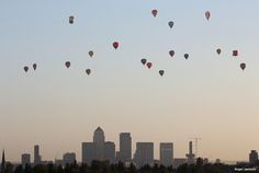 June 2015 Hot air balloons over London at #sunrise on Sunday. Pic by Roger Jackson. More UK pics: http://bbc.in/1HWg0pt Lan